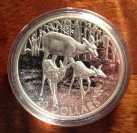 Deer family on a Canadian Siilver Twenty dollar coin